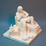 Стилизованная скульптура- Читатель. Мелка пластика, белая глина. Высота см., ширина см.